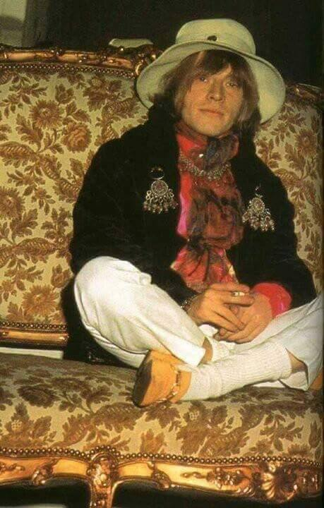 Brian Jones wearing earrings on his lapels